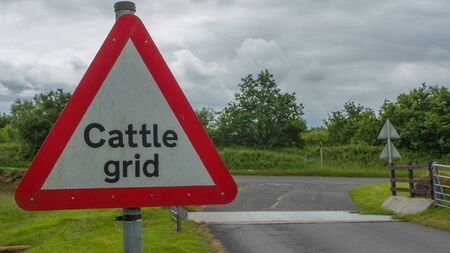 obstruction: Cattle Grid Sign next to Cattle Grid Stock Photo
