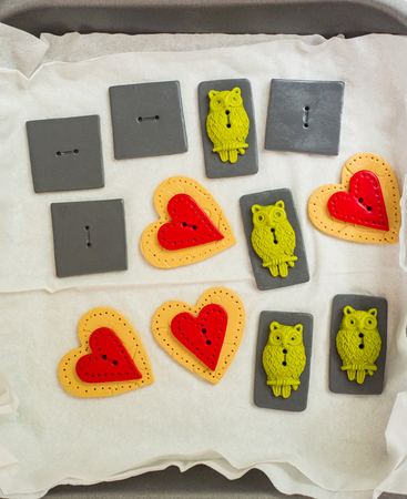 arts and craft polymer clay owl buttons and hearts ready for baking