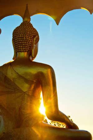Buddha statue and Sunshine at thailand Stock Photo - 12086493