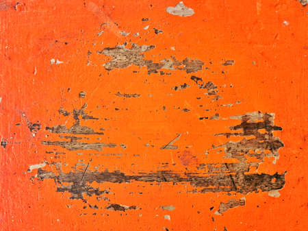 The painted wood surface is orange, cracked and damaged. Imagens