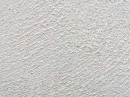 Jagged marks on white concrete walls.