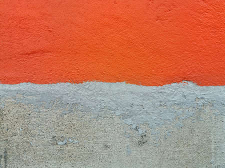 Orange concrete wall and unpainted walls. Rough surface. Imagens
