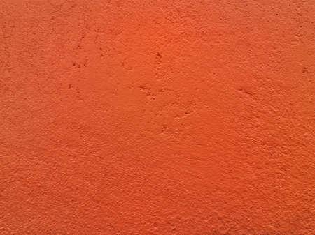 Orange concrete wall. Rough surface.