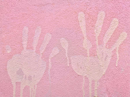 Hand stains on pink concrete walls. Concrete wall surface. Pink color beautiful. Imagens