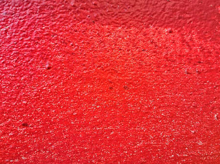 The rough surface of red concrete.