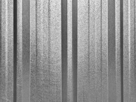 Lighting and shadow surface of metal sheet wall gray color. Roof or wall made from zinc. Standard-Bild