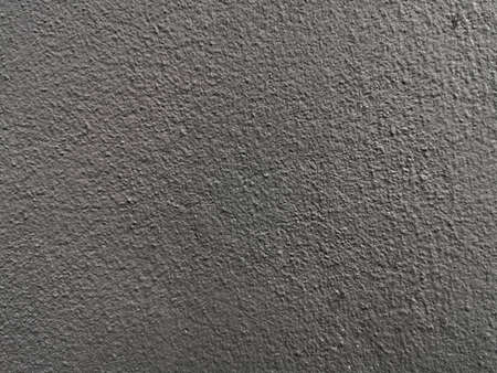 Glossy Black Concrete Wall. Rough surface of the cement wall Imagens