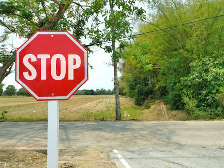 Stop red traffic sign. Stop before reaching the crossroads for safety reasons. Warning signs on the road. Reduce speed and lower gear. Stock fotó