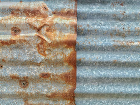 Old zinc walls rusting, overlapping. Roof zinc.