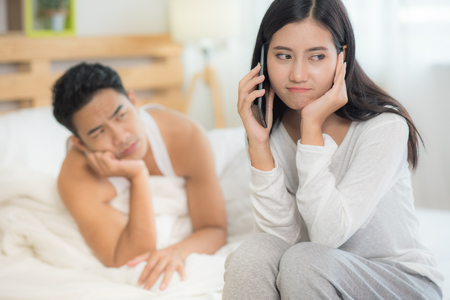 Husband try to reconcile wife over quarrel issues. Depressed sad wife still suffering. Conflict management skill.