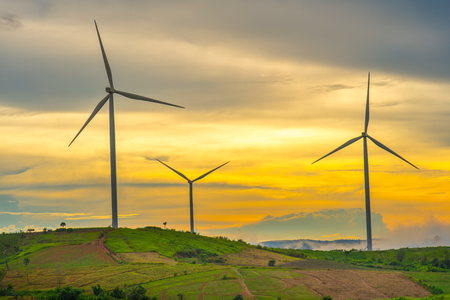 Wind generators turbines at sunset. Beautiful mountain landscape with wind generators turbines at Khao Kho mountain, Thailand. Renewable energy concept.
