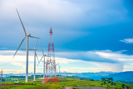 Beautiful mountain landscape with wind generators turbines and high voltage tower at Khao Kho mountain, Thailand. Renewable energy concept.