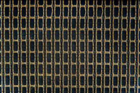 Closeup of old type loudspeaker weaving with thread. Retro loudspeaker wallpaper.