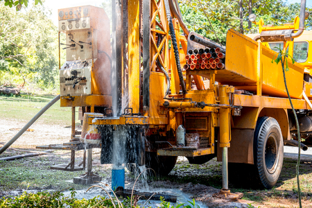 Ground water hole drilling machine installed on the old truck in Thailand. Ground water well drilling.