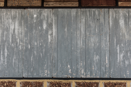Old wooden plank and brick wall pattern. Antique rough and rustic wall of rural house. Stock Photo
