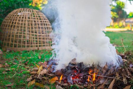 Fire causes smoke Stock Photo