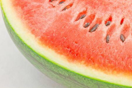 hemispherical: Hemispherical split watermelon on a white background.