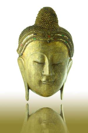 Gold Buddha head on shadow background  photo