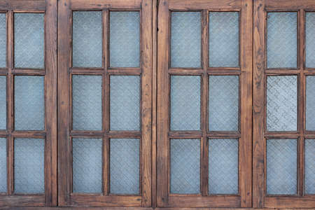 Wooden window with stainglass