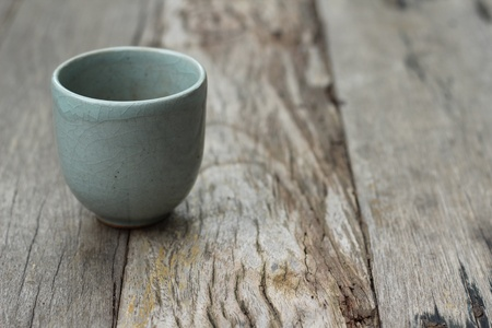 Ceramic tea cup on planks Stock Photo