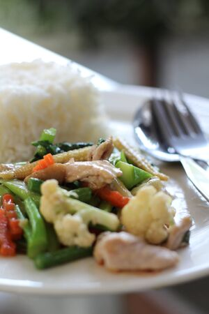 Mixture of vegetables fried with rice photo