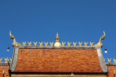 Roof of thai temple and blue sky photo
