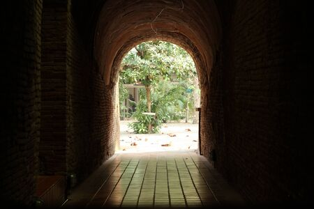 The end of tunnel,Wat Umong,Chiangmai,Thailand Stock Photo