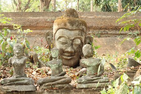 blissfull: Old buddha statue in old temple Stock Photo