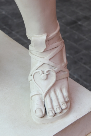 peep toe: Foot of a statue with sandals