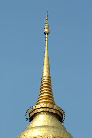 Golden chedi in Wat Phra That Lampang Luang,Lumpang,Thailand photo