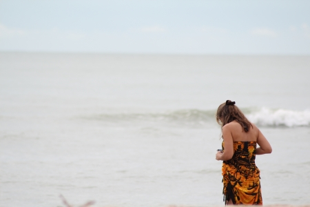 Woman on beach, Cha-am beach, Thailand photo