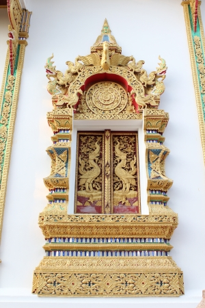 Thai temple window, Wat Phra That Doi Kum, Chiangmai, Thailand photo