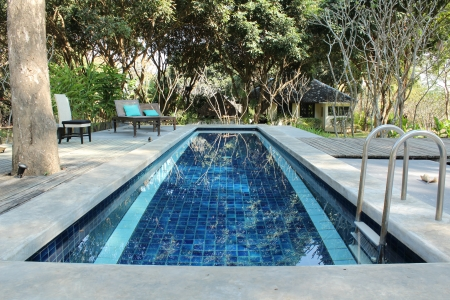 Small swimming pool in small hotel photo