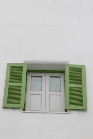 Window on white wall photo