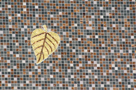 Tiled mosaic of gold leaf on wall photo
