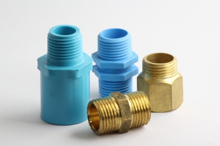 Pipe brass and PVC fitting  Stock Photo
