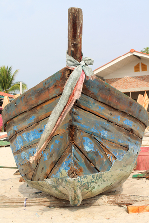 prow: The prow of old wooden boat on the beach.