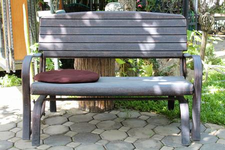 Brown bench in the garden. photo
