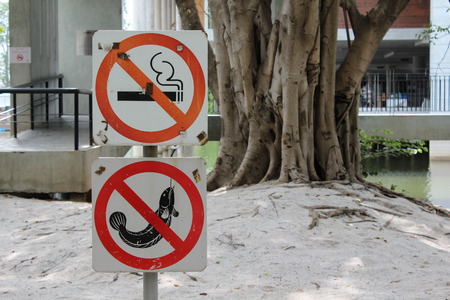 No smoking and no fishing sign in the park. photo
