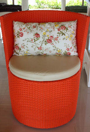 Red chair, woven rattan furniture.