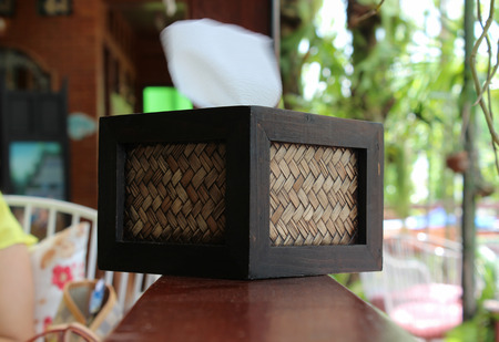 Tissue paper box made by basketry bamboo on wooden stick. photo
