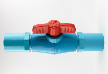 half ball: PVC ball valve and fittings on white background.