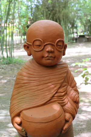 ordinate: Doll clay monk in Cherntawan International Meditation Center, Chiangrai, Thailand.