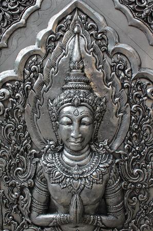 act of god: Deva silver carving art on temple wall. Wat Srisupan, Chiangmai, Thailand.