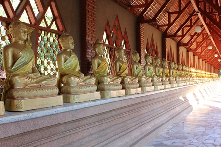 seated: A row of seated buddhas at the temple in Wat Rom Luang, Maetang, Chiangmai, Thailand. Stock Photo