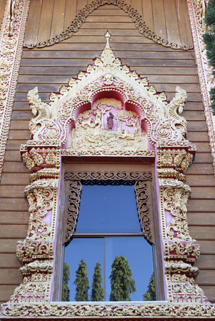 Thai temple window at Wat Rom Luang, Maetang, Chiangmai, Thailand. photo