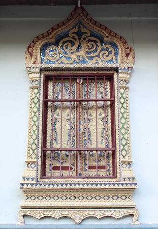 rom: Thai temple window at Wat Rom Luang, Maetang, Chiangmai, Thailand.
