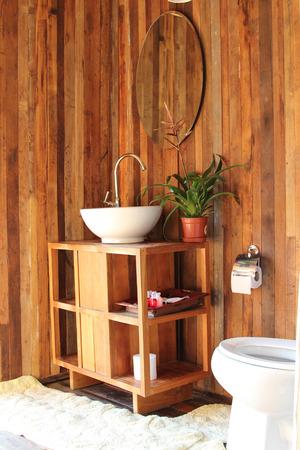 ensuite: Hand wash basin on wooden table in bathroom wooden design.