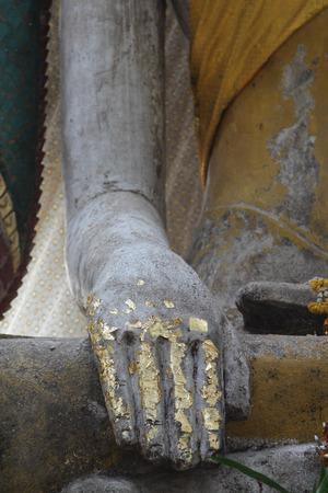 buddha hand: Closeup of buddha hand statue in old temple. Stock Photo