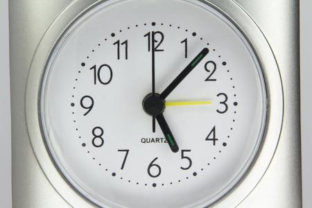 turn dial: Desktop quartz alarm clock isolated on white background.